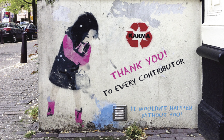 Street graffiti of girl with watering can and Thank You message. (Credit: Chris McDowel)l